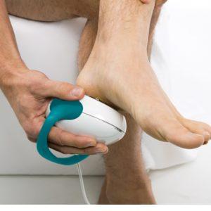 Man treating leg pain
